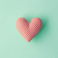 Vintage cotton stuffed heart over blue background
