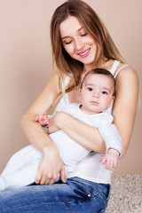 Happy young mother with her little son