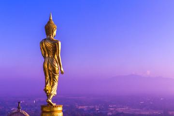 Buddha standing on a mountain Wat Phra That Khao Noi