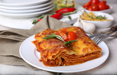 Portion of tasty lasagna on table