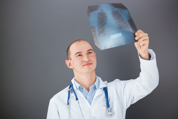 Young doctor looking at xray.
