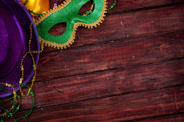 Mardi Gras: Mask And Purple Hat With Wood Background Wall mural