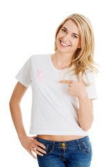 Woman with pink breast cancer awareness ribbon