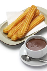 churros and hot chocolate on white background