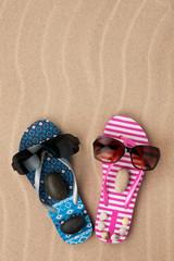 Loving couple of flip flops on the sand