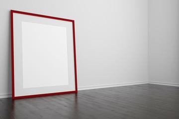 Roter leerer Rahmen steht auf dem Boden