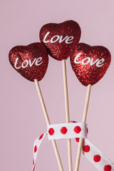 Three red hearts with the word Love