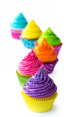Wall Mural - Row of colorful cupcakes