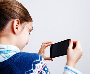 Little girl using mobile phone