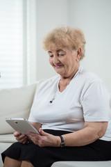Modern grandma using tablet
