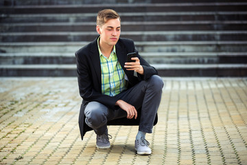Young man calling on the mobile phone outdoor