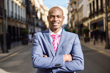 Handsome black man wearing suit in urban background