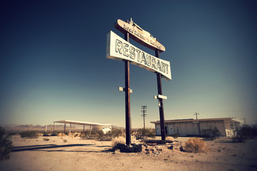 Historic vintage restaurant and gas station sign on old Route 66 in the desert, California, USA