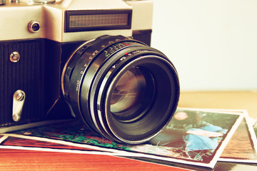 close up photo of old camera lens over wooden table. image is re
