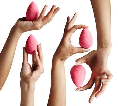 hands, holding a bright makeup sponge