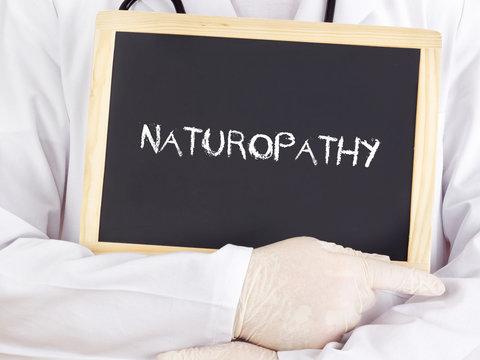 Doctor shows information on blackboard: naturopathy