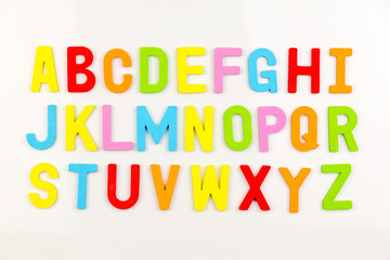 Alphabet magnets on whiteboard