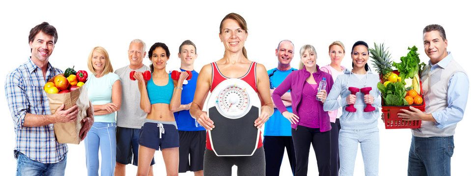 Group of sportive people with vegetables.