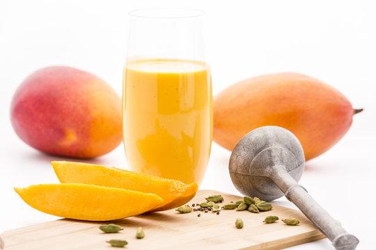Crushed Cardamon, Pestle, Mangos And Mango Lassie