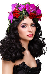 beautiful girl with a wreath of orchids on head.