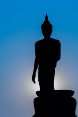 Silhouette of standing big Buddha statue during twilight time