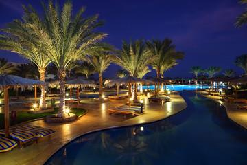 Fototapete - LuxuryTropical Resort Pool in dusk