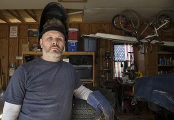 Man wearing welding helmet