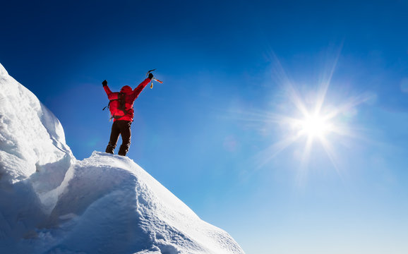 Mountaineer celebrates the conquest of the summit.