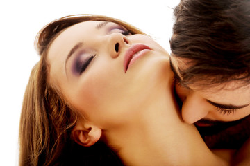 Handsome man kissing woman's neck.