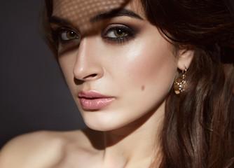 Beautiful sexy brunette woman evening make-up beauty portrait