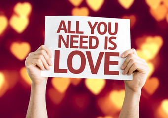All You Need is Love card with heart bokeh background