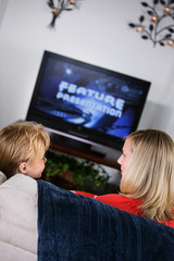 Family: Mother And Son On Couch For Movie Night