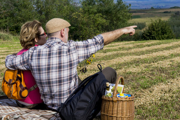 Wall Mural - Senior couple sitting in the field