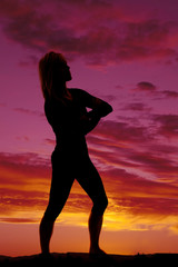 silhouette of a woman arms folded standing