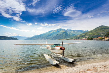 Float plane docked at a beach on Lake Como in Italy, Europe