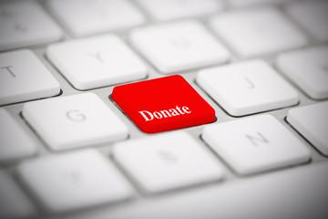 "The word ""DONATE"" written on keyboard"