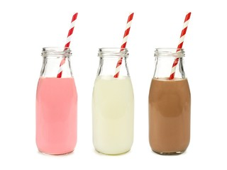 Ingelijste posters Milkshake Strawberry regular and chocolate milk in bottles isolated