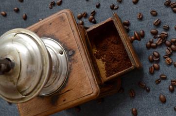 Coffee beans with vintage grinder