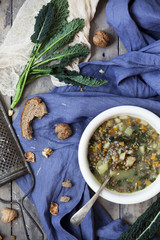rustic vegetables soup with legumes and lacinato kale