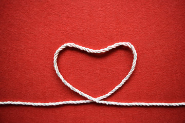 Valentines day card - heart made from wire on red background