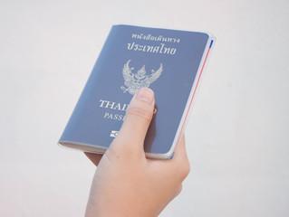 Thailand passport in hand women