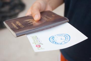 Thailand passport and postcard in hand women