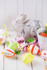 Easter rabbit and decorative eggs.