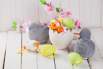 Colorful easter eggs  and stone birds