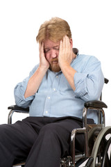 Depressed Disabled Man In Wheelchair