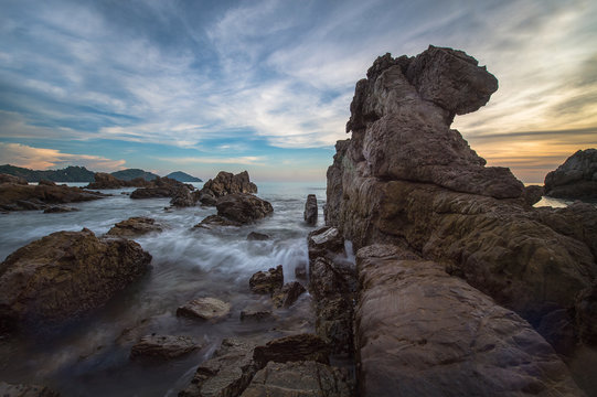 Seascape with the rock and sunset light
