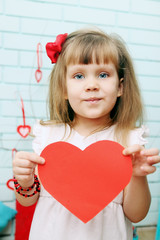 girl holding heart in hands