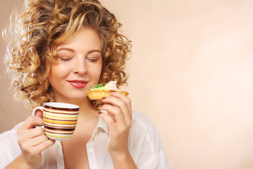 woman with coffee and cookies.