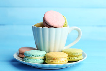 Assortment of gentle colorful macaroons in colorful mug