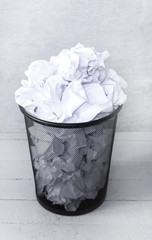 White paper in the trash can